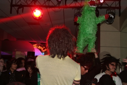 crowd surfing dinosaur photo from stage