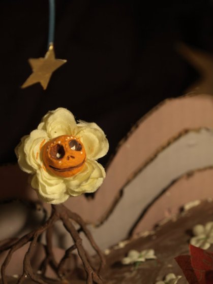 flau flower with roots & hanging star above